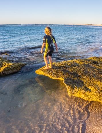 Mia exploring the rock pools, Ningaloo Coast